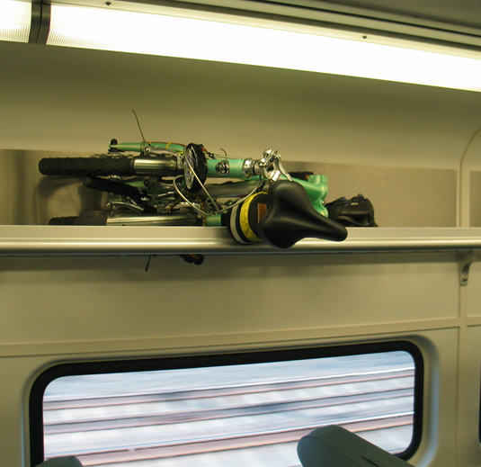 mini-folding-bike-overhead-bin-train.jpg